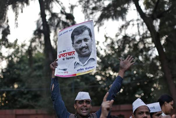 A supporter of Aam Aadmi (Common Man) Party (AAP) holds a portrait of Delhi's chief minister Arvind Kejriwal during a protest in New Delhi January 20, 2014 REUTERS/Ahmad Masood