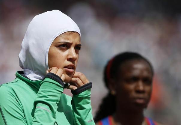 Saudi Arabia's Sarah Attar prepares to compete in her women's 800m round 1 heat during the London 2012 Olympic Games at the Olympic Stadium, August 8, 2012. REUTERS/Lucy Nicholson