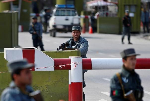 An Afghan policeman takes up a position at the main checkpoint leading to the Interior Ministry, after a suicide bomb blast in Kabul April 2, 2014. REUTERS/Ahmad Masood