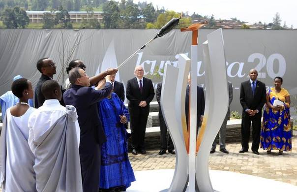 U.N. Secretary General Ban Ki-moon (5th L), Rwandan President Paul Kagame (2nd L), his wife Jeannette Kagame and the African Union Commission Chairperson Nkosazana Dlamini Zuma (6th L) light a flame at the commemoration of the 20th anniversary of the Rwandan genocide in Kigali April 7, 2014. REUTERS/Noor Khamis
