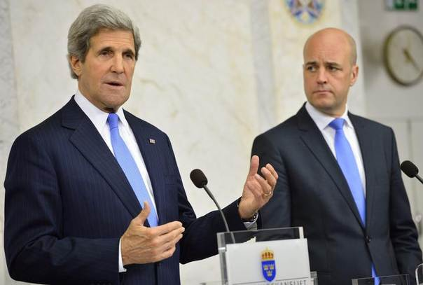U.S. Secretary of State John Kerry (L) speaks during a news conference with Prime Minister Fredrik Reinfeldt at the government building Rosenbad in Stockholm, May 14, 2013 REUTERS/Henrik Montgomery/Scanpix Sweden