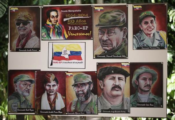 Paintings of the founders of Colombia's guerrilla group FARC are seen during a news conference in Havana May 27, 2014.  REUTERS/Enrique De La Osa
