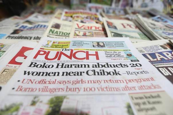 A newspaper with its frontpage headline on an abduction of women from a village in northeast Nigeria, is displayed at a vendor's stand along a road in Ikoyi district in Lagos, Nigeria, June 10, 2014. REUTERS/Akintunde Akinleye