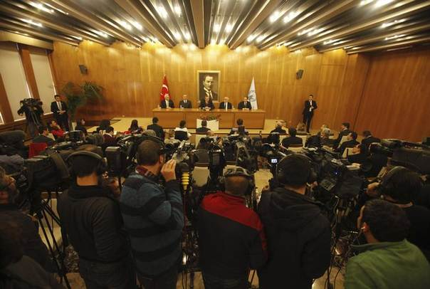 Cameramen film a news conference by Turkey's Prime Minister Tayyip Erdogan in Istanbul February 3, 2014 REUTERS/Osman Orsal