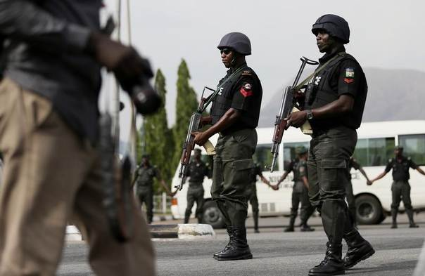 Police officers patrol during a protest in Abuja, Nigeria, May 22, 2014. REUTERS/Afolabi Sotunde