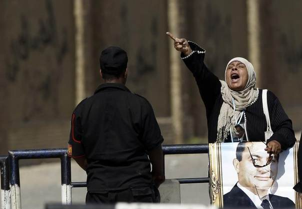A supporter of Egypt's former president Hosni Mubarak shouts slogans against Egyptian President Mohamed Mursi and members of the Muslim Brotherhood outside the police academy, where Mubarak's trial will take place, in Cairo May 11, 2013 REUTERS/Amr Abdallah