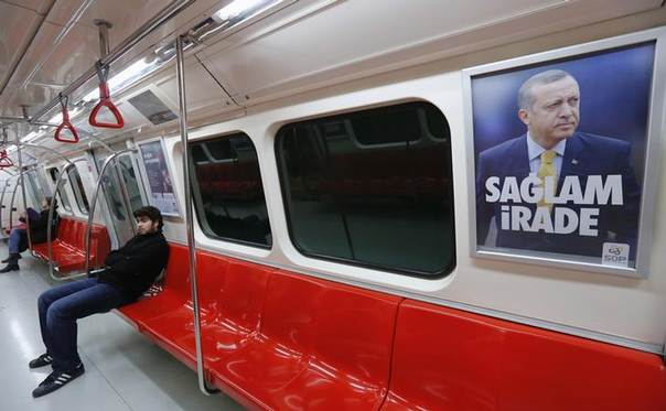 An advertisement poster with a picture of Turkish Prime Minister Tayyip Erdogan is pictured inside a metro train in Istanbul January 13, 2014 The slogan on the pro-Erdogan advertisement poster placed by the Civil Solidarity Platform reads as