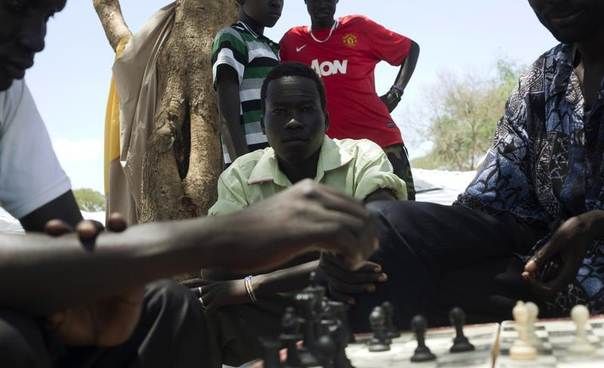 South Sudanese men displaced by recent fighting play chess at the Bor camp for the internally displaced in Bor town, Jonglei state, April 29, 2014. REUTERS/Carl Odera