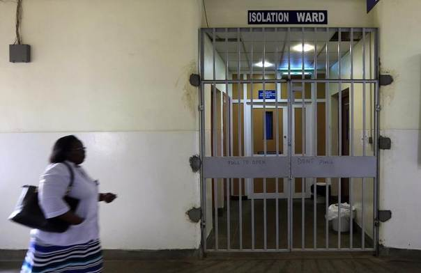 A woman walks past an isolation ward set aside for Ebola related cases at the Kenyatta National Hospital in Nairobi, Kenya, August 19, 2014. REUTERS/Noor Khamis