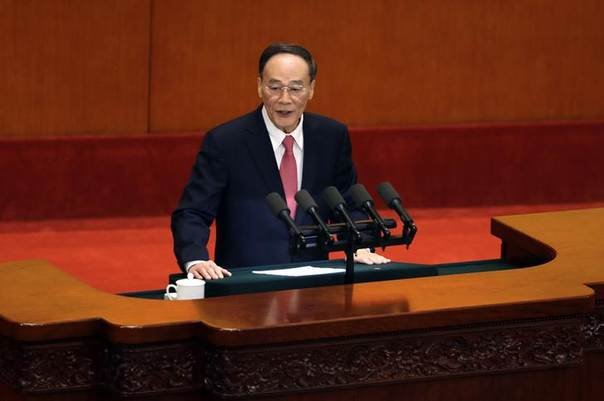 China's Politburo Standing Committee member Wang Qishan speaks at the opening ceremony of the 11th National Women's Congress at the Great Hall of the People, in Beijing, October 28, 2013. REUTERS/Jason Lee