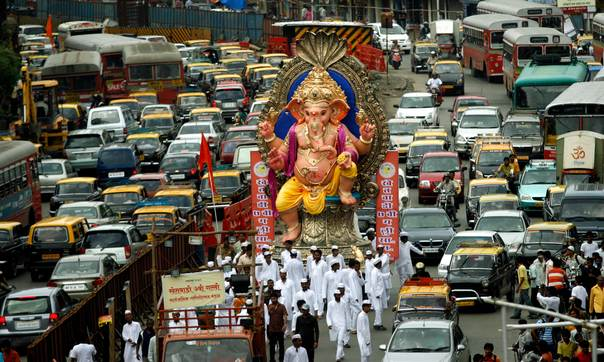 In a 2009 file photo, Devotees pull a huge idol of