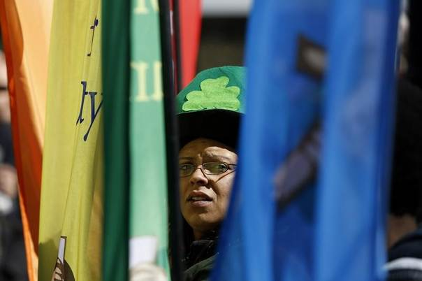 A member of the South Boston Association of Non Profits prepares to march in the St. Patrick's Day parade in Boston, March 16, 2014. REUTERS/Dominick Reuter
