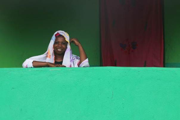 A woman smiles as she poses for a photo in Soko, around 7 km (4.3 miles) away from Ivoary Coast's border with Ghana July 3, 2013. REUTERS/Thierry Gouegnon