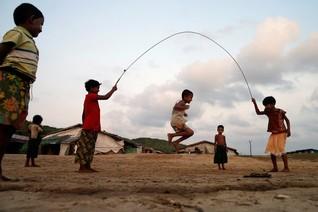 Boys play inside a Rohingya refugee camp outside Kyaukpyu