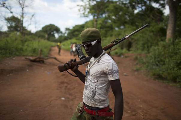 An anti-Balaka militiaman poses for a photograph next to a checkpoint on a dirt road near the town of Yaloke April 24, 2014. REUTERS/Siegfried Modola