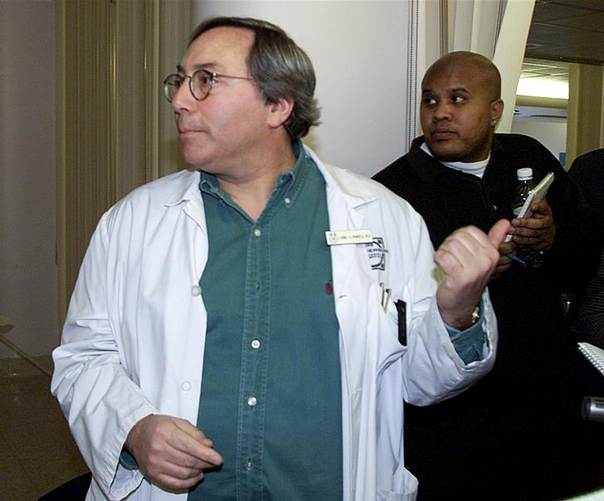 Dr. Lionel Mandell, who works in the infectious-disease wing, speaks to reporters regarding the condition of a 32-year-old Congolese woman who is being treated at the Henderson General Hospital in Hamilton, Ontario, Canada, for symptoms resembling the deadly Ebola virus, February 7, 2001.