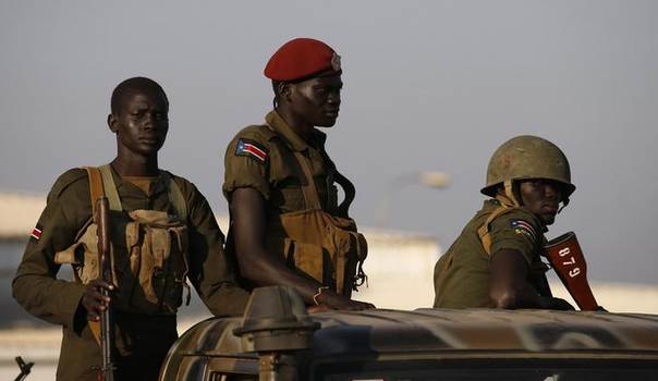 SPLA soldiers stand in a vehicle in South Sudan capital Juba December 20, 2013.  REUTERS/Goran Tomasevic