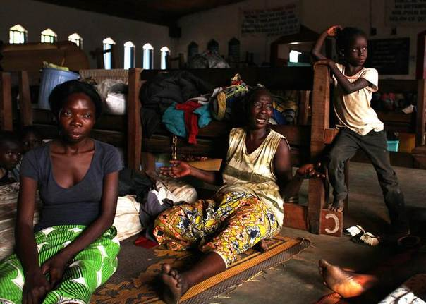 Women rest at a temporary camp for Internally Displaced Persons (IDP) in a church building in the Central African Republic capital of Bangui, a day after Christian militia attacked Muslim districts in the city. Picture December 21, 2013, REUTERS/Andreea Campeanu