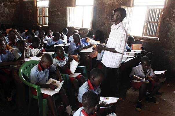 A teacher talks to students before the start of an English lesson at a public school in Gudele, on the outskirts of South Sudan's capital Juba. Picture taken April 8, 2013, REUTERS/Andreea Campeanu