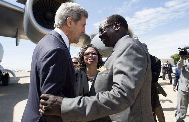 South Sudan's Foreign Minister Barnaba Marial Benjamin (R) greets U.S. Secretary of State John Kerry upon his arrival aboard a U.S. military airplane at Juba international airport May 2, 2014 REUTERS/Saul Loeb/Pool