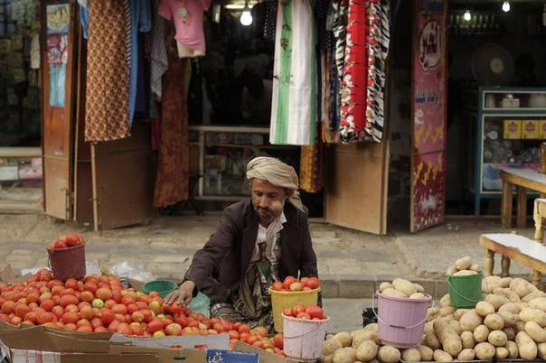 A street vendor chews qat, a mild stimulant, as he sits by his vegetable stall at a market place in the Old Sanaa city March 19, 2014. REUTERS/Khaled Abdullah