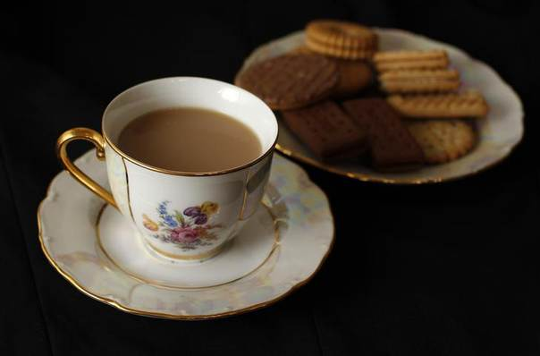 A cup of tea and plate of biscuits, London June 6, 2012. REUTERS/Suzanne Plunkett