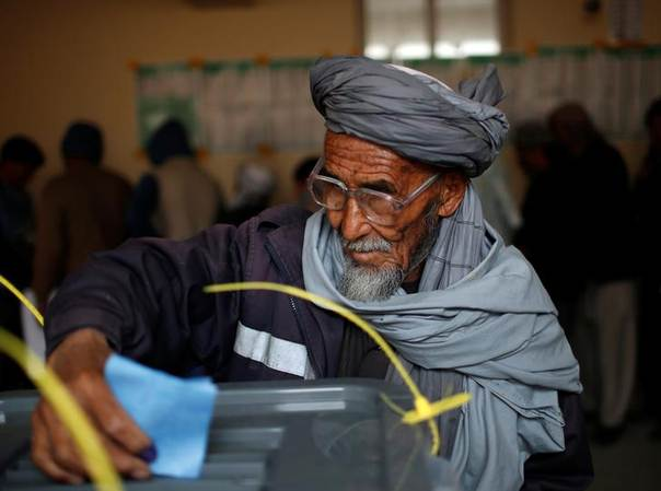 Afghan man casts his vote at a polling station in Kabul April 5, 2014. REUTERS/Ahmad Masood