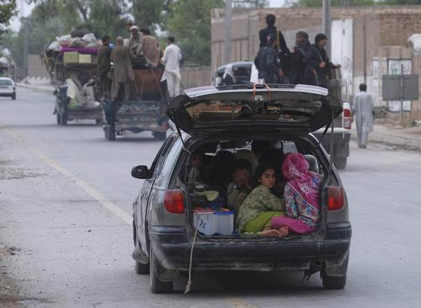 Children fleeing the military offensive against the Pakistani militants in North Waziristan, sit in a vehicle with their family while entering in Bannu, located in Pakistan's Khyber-Pakhtunkhwa province June 18, 2014 REUTERS/Khuram Parvez