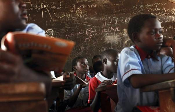 Students attend a lesson at a public school in Gudele, on the outskirts of South Sudan's capital Juba, April 8, 2013. REUTERS/Andreea Campeanu