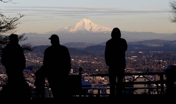 People look at Mount Hood, scene of a climbing accident