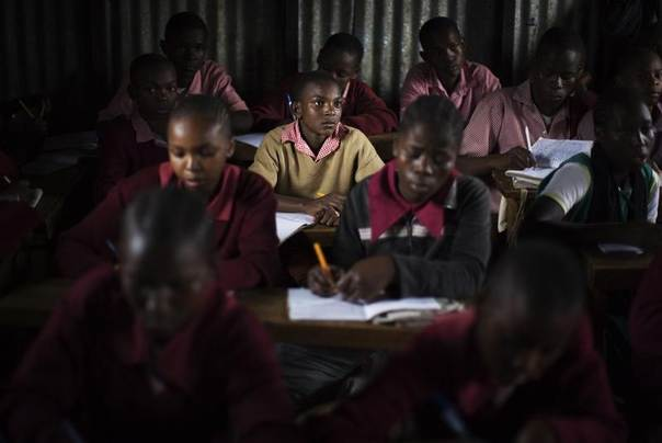 In this 2009 file photo students attend a class at the New Hope Kibera Bible Baptist Church Primary School in Kibera slum, Nairobi, Kenya. REUTERS/Finbarr O'Reilly
