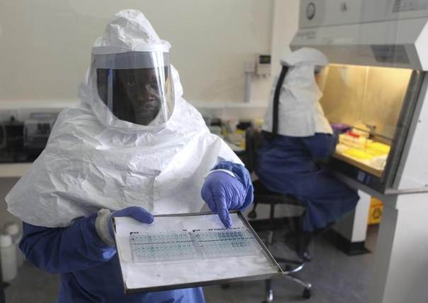 A doctor displays collected samples of the Ebola virus at the Centre for Disease Control in Entebbe, southwest of Uganda's capital Kampala, August 2012. REUTERS/Edward Echwalu