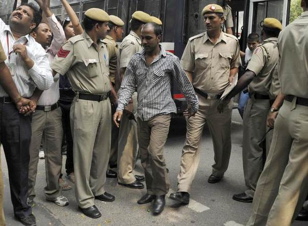 Mukesh Singh (C), one of four men sentenced to death for the rape and murder of a woman on a bus, is escorted by police outside a court in New Delhi. Picture September 24, 2013,  REUTERS/Stringer