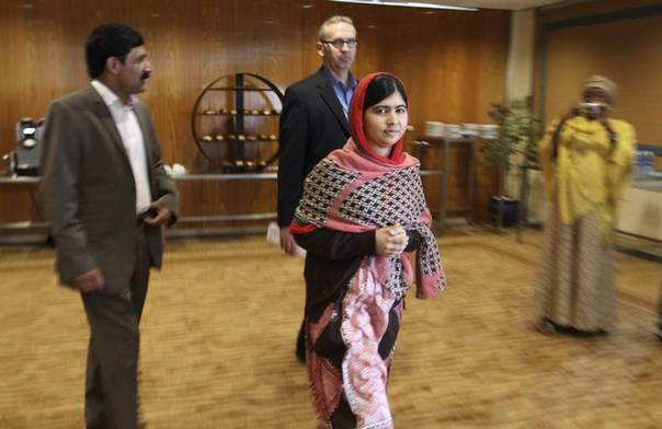 Pakistani schoolgirl activist Malala Yousafzai arrives for a meeting with the leaders of the #BringBackOurGirls Abuja campaign group, in Abuja July 13, 2014. REUTERS/Afolabi Sotunde