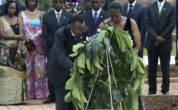 In this 2009 file photo, Rwanda's President Paul Kagame and first lady Jeannette Kagame lay a wreath at a mass grave in the capital Kigali REUTERS/Hereward Holland