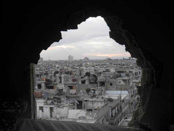Damaged buildings are pictured in the besieged area of Homs January 12, 2014.