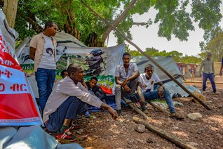 FEATURE-Driven away by conflict, thousands of Ethiopians stranded without a home