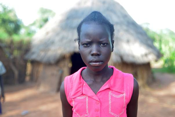 CARE/Tom Perry. Nyabel* (name changed) is 15 years old. She and her family fled when fighting erupted in her village. Now, she is the de facto leader of the children in her family.