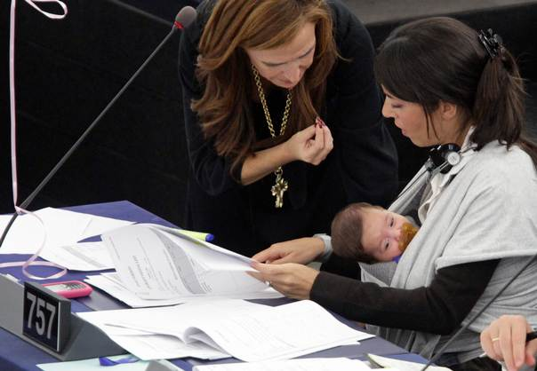 Italy's Member of the European Parliament Licia Ronzulli (R), with her baby Vittoria on her lap, talks with a fellow MEP in Strasbourg during a session on women's working conditions on October 20, 2010. REUTERS/Jean-Marc Loos