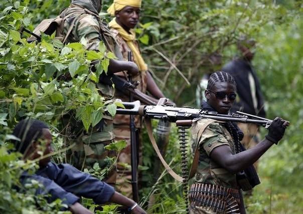 A Seleka fighter holds his machine gun near the town of Kuango, close to the border with Democratic Republic of Congo June 9, 2014. REUTERS/Goran Tomasevic