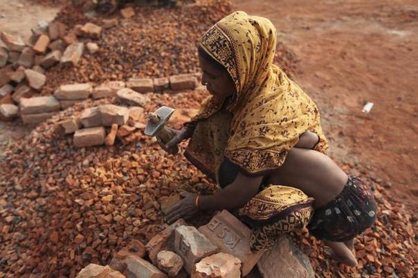 Renu Bibi works in a brick field earning 60 TK ($0.85) per day. Renu and her husband migrated to Dhaka from Bhola, a southern district of Bangladesh, 20 years ago after they lost their lands and house to the river Meghna due to severe erosion and heavy storms, December 7, 2009. REUTERS/Andrew Biraj