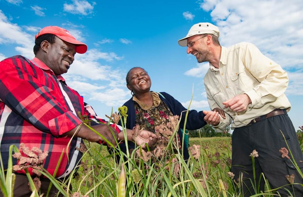 The Crop Trust's Dr Benjamin Kilian (right) with the Crop Wild Relatives' finger millet pre-breeding partner, Dr Chrispus Oduori , and Margaret Kubende, a farmer, in her finger millet field in Kakamega County in Western Kenya. Margaret is a diabetic and planted finger millet since it is gluten free and helps keep blood sugar levels low. Supplied: Michael Major/Crop Trust