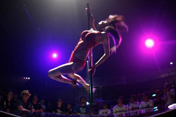 A pole dancer performs during Chopper Night 2008 in Tokyo, on July 27, 2008. REUTERS/Yuriko Nakao