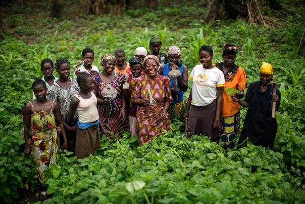 The 2013 UNHCR Nansen Refugee Award winner Sister Angélique Namaika (centre) poses with a group of Congolese women she is assisting on a farm project she runs near the town of Dungu, Oriental Province, DRC. August 2013 UNHCR/Brian Sokol