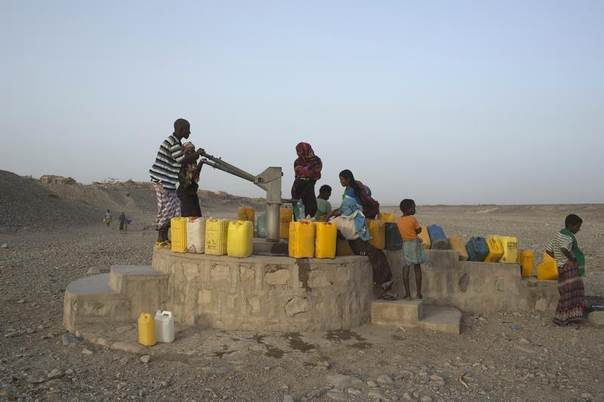 Residents of Hamad-Ile pump water from a well in the Danakil Depression, northern Ethiopia, April 21, 2013. The Danakil Depression is one of the hottest and harshest environments on earth, with an average annual temperature of 94 degrees Fahrenheit (34.4 Celsius). REUTERS/Siegfried Modola