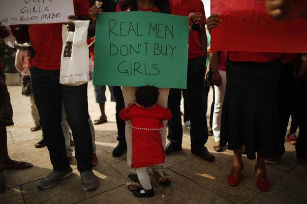 Nigerians take part in a protest, called by Malaga's Nigerian women Association, for the release of the abducted secondary school girls in the remote village of Chibok in Nigeria, at La Merced square in Malaga, southern Spain May 13, 2014. REUTERS/Jon Nazca