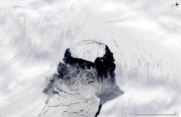 An iceberg which was part of the Pine Island Glacier is shown separating from the Antarctica continent in this MODIS image taken by NASA's Aqua satellite on Nov. 10, 2013 and released by NASA Nov. 14, 2013. REUTERS/NASA/Handout via Reuters