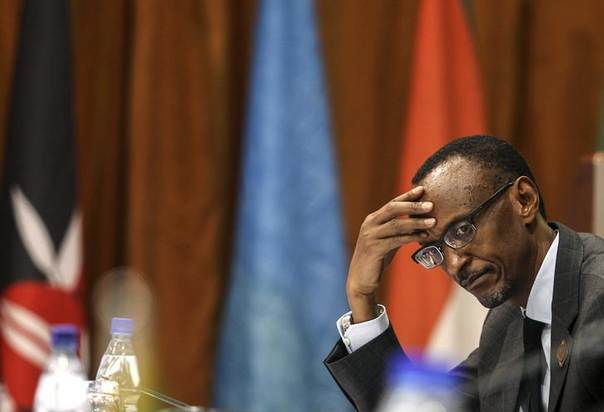 Rwanda's President Paul Kagame listens to deliberations during the International Conference on the Great Lakes Region (ICGLR) at the Commonwealth Resort Hotel Munyonyo in the Ugandan capital of Kampala August 8, 2012. REUTERS/Edward Echwalu