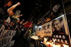 Protesters chant slogans to mourn the death of Nobel laureate Liu Xiaobo in Hong Kong