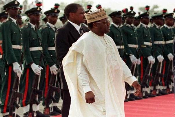 In this 1998 file photo, then Nigerian President General Sani Abacha walks past a line of military troops REUTERS/Reuters photographer